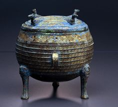 Eastern Zhou Period Chinese Bronze Elliptical Vessel with Lid (Ding) with Gold Sheet and Glass Inlay      	Bronze, gold sheet, glass, 4th  century B.C.E.