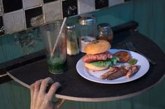 zombie meals - salt, pepper, half filled glass of green stuff, hamburger, finger fries