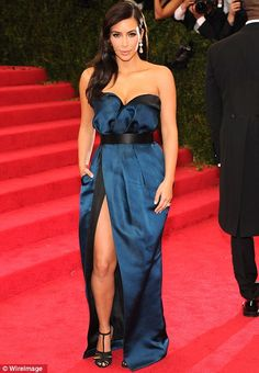 Met Gala 2014.    What happened in that limo ride? Kim Kardashian switched out her shoes and belt as she lost the leather cuffs en route to the Met Gala