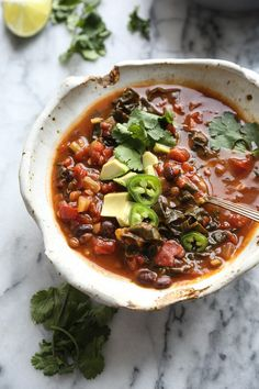 This lentil chili recipe is an easy vegetarian dish to throw in your crockpot. It's packed with super foods and protein--kale, pumpkin and black beans!