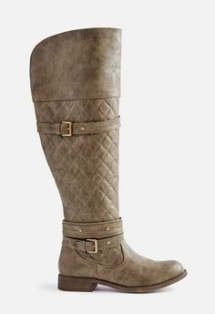 A burnished faux leather boot with a classic strap and buckle detail at the ankle and vamp. Inner zip closure. ...