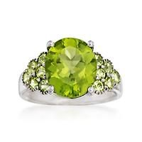 """5.20 ct. t.w. Peridot Ring in Sterling Silver. Size 8"": ""A 4.30 carat oval peridot beams a bright green amid .90 ct. t.w. round peridots…"