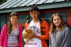 A boy, two girls and a chicken