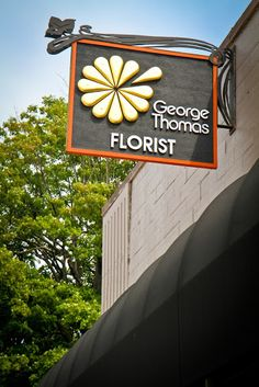 George Thomas Store Sign support your local florist Indianapolis Indiana Shop Signage, Wayfinding Signage, Signage Design, Environmental Graphics, Environmental Design, Sign Installation, Outdoor Signage, Fun Signs, Indianapolis Indiana