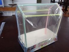 homemade greenhouse half gallon milk or juice carton 7 bendy straws 2 large plastic bags or other clear plastic sheets tape (we used packaging tape) 2 pennies Greenhouse Kitchen, Backyard Greenhouse, Small Greenhouse, Greenhouse Wedding, Greenhouse Ideas, Portable Greenhouse, Stardew Valley Greenhouse, Milk Carton Crafts, Clear Plastic Sheets