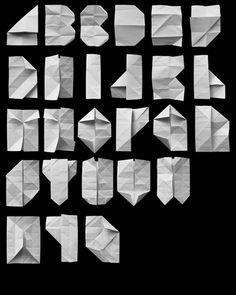 Cool folded paper font - http://www.cubeecraft.com/blog/wp-content/uploads/2009/05/alphabet_fold.png
