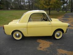 1959 Autobianchi 2 DOOR. Don't think I wouldn't drive this...I find it to be adorable. I wanna pinch its' widdle hubcaps.