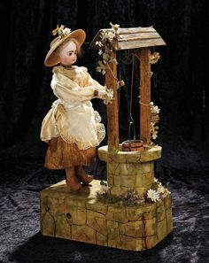 """Soirée: A Marquis Cataloged Auction of Antique Dolls and Automata - May 14, 2016: Lot 42. Very Rare French Musical Automaton """"Country Girl at the Well"""" by Roullet et Decamps"""