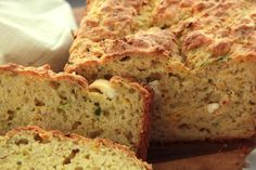 Use up extra zucchini or summer squash in this savory version of zucchini bread flavored with feta cheese, oregano, and black pepper.