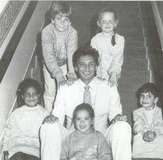 Barry Manilow and bunch of children.