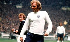 Coolest football shirt ever. Player is Bobby Moore. Team is England. Decade is the 1960's. Not sure I like the haircut though.