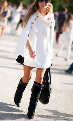 #streetstyle | a white military cape over a black mini flared skirt paired with knee high boots