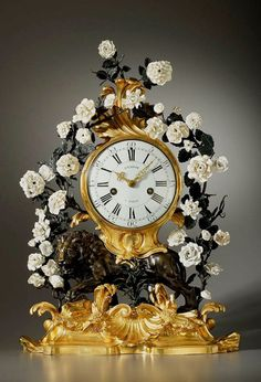 Antique clock French ca 1800. Beautiful mantel clock in gilded bronze with white flowers of Sèvres Porcelain.