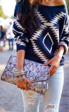 Navy and white aztec sweater and weathered jeans
