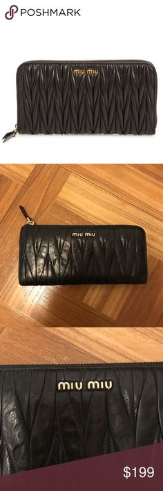 "MIU MIU Pre loved wallet by Miu Miu. I got this as a gift in 2010, and wore for about a year and have and in my closet. There are some signs of wear as shown in the images, but overall in good condition and a great price considering. At the time of buying it was around $500/$600 with tax.   Zip-around closure Interior zip, wall and currency pockets; 12 card slots Nappa leather Made in Italy 8""W x 4""H x 1""D Miu Miu Bags Wallets"