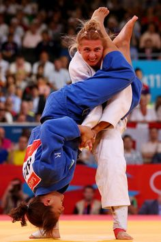 Sarah Menezes of Brazil (blue) competes against Alina Dumitru of Romania to win the gold medal in the Women's -48 kg Judo on Day 1 of the London 2012 Olympic Games at ExCeL on July 28, 2012 in London, England.