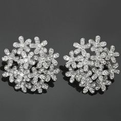 Van Cleef & Arpels Socrate Bouquet Diamond Gold Earrings | From a unique collection of vintage lever-back earrings at https://www.1stdibs.com/jewelry/earrings/lever-back-earrings/
