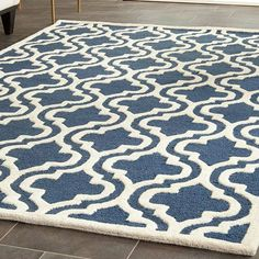 Anchor your living room seating group or define space in the den with this artfully hand-tufted wool rug, featuring a quatrefoil ogee motif for eye-catching appeal.