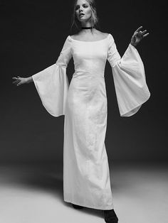 Natasha's Limited Edition White Dress | With elegance and grace make a boho statement in this beautiful maxi dress.  Featured in a crinkly fabric and off-the-shoulder design this gown has dramatic wide bell sleeves and a hidden back zip. American made.