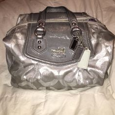Authentic Metalic Coach Purse Super cute coach purse. Comes with a dust bag and an extra strap to wear it a different way .To switch up the look of the bag . In good condition. Coach Bags Hobos