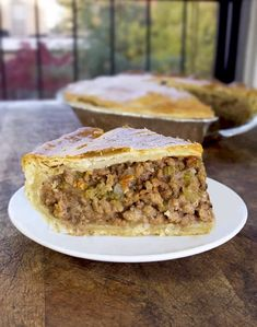 This Turkey Tourtiere (meat pie) recipe is a healthy spin on a French Canadian classic. The turkey keeps it lean, but the taste is decadent and savory. Perfect for Thanksgiving – or a comfort food fix in the dead of winter! Ground Turkey Dinners, Ground Turkey Recipes, Ground Turkey Meat Pie Recipe, Pie Recipes, Dinner Recipes, Cooking Recipes, Dinner Entrees, Burger Recipes, Gourmet