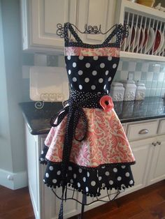 Love this apron ... very 50's housewife ... i am very tempted to buy this and save it for weekends when (once they are old enough) the kids go to gammas , it would look great over lingerie and a pair of heels