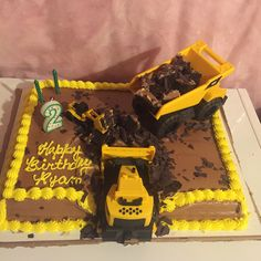 Construction cake! - Costco cake - chocolate shavings - construction vehicles