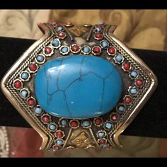 Antique style Afghan  cuff with turquoise stone NWOT Original antique style Afghan cuff with big turquoise stone. Jewelry Bracelets