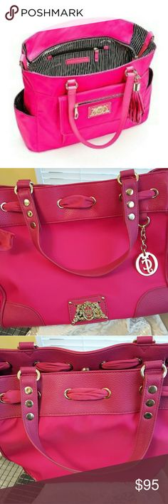 EUC JUICY COUTURE DIAPER BAG BEAUTIFUL HOT PINK nylon  DIAPER BAG. Looks more like a large tote, than your ordinary diaper bag. Give that specially new Mommy of that precious little princess the bag a Lil Princess deserves. (AS WELL AS MOMMY) Bought for myself when my Grandaughter was born. Turned out I bought my Daughter in Law her own, and it was always with the Princess. Mine was barely used at all. Maybe once or twice. Juicy Couture Bags Baby Bags