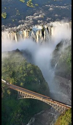 This is the Victoria Falls Bridge which crosses the Zambezi River just below the Victoria Falls. - via Susana Crespo's photo on Google+ www,facebook.com/loveswish