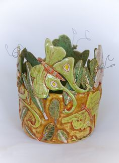 I love this creative and very special piece of pottery.