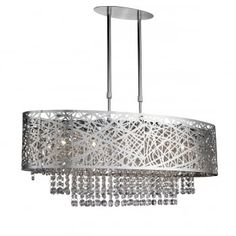 This Mica Chrome 5 Light Fitting with Crystal Drops is modern and artistic. It has a large oval chrome finish shade with patterned metal and gaps, which creates nice light and shadows, and the centre contains a five light fitting as well as clear crystal Bar Pendant Lights, Pendant Light Fitting, Drum Pendant, Glass Pendant Light, Lantern Pendant, Crystal Ceiling Light, Semi Flush Ceiling Lights, Chandelier Ceiling Lights, Ceiling Pendant