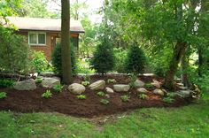 boulder retaining wall   View from my place. Planted 3 6' Norway Spruce and one 3'. Added some ...