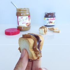 A petite mid-day snack: speculoos cookie butter and nutella sandwiched between petite toasts. These crackers are actually for pairing with Pâté but I think I found a better use. #sandwich #nutella #speculoos #sandwiches #snack