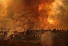 How Did Fort McMurray Get Out Alive? by Anne Kingston, Maclean's, May 7, 2016. -- 'They were ready,' says one fire expert who knows first hand what it's like to fight an unpredictable wildfire. | Image: Fire seen from the highway in Fort McMurray, May 4, 2016.