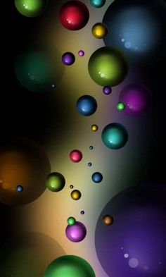 Abstract Art: Rainbow colored bubbles and balls floating through air and space. #rainbow