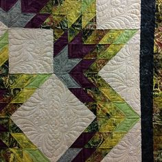 No diamonds in the sky quilt patter with feather quilting by Elizabeth Karnes