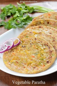 Paratha is a easy, healthy flat bread with goodness of vegetables, is a meal in itself! It is quite a filling meal to suit any time of the day… be it breakfast, lunch or snack! Ever since i tried frozen Deep brand Veg Paratha, I'm in love with - p North Indian Recipes, Indian Food Recipes, Vegetarian Recipes, Healthy Recipes, Indian Vegetable Recipes, Vegetarian Breakfast Recipes Indian, Veg Recipes Of India, Jain Recipes, Indian Snacks