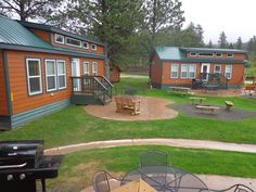 Deluxe Cabin village each with their own patio sites at the Mt. Rushmore KOA Resort at Palmer Gulch