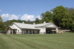 This hangar was built for Dave of Cambridge OH Special Features: Morton's Hi-Rib Steel Hydroswing Door Cupolas Porch Stone Wainscot M. Pole Barn House Plans, Pole Barn Homes, Barn Plans, Pole Barns, Metal Building Homes, Building A House, Building Ideas, Metal Homes, Building Quotes