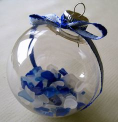 Add tiny bits of sea glass, sand, or shells to an ornament for a beautiful keepsake