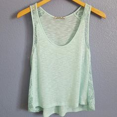 "Chloe K lace top Sea glass green/light blue sheer top. Beautiful lace detail sides. Excellent condition. Never worn. 21 1/2"" in front shoulder to hem. 23 1/2"" in back. Chloe K Tops"