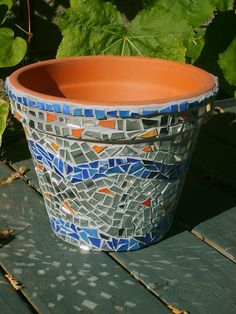 This mosaic plant pot was made from a terra cotta pot, recycled glass, and mirror