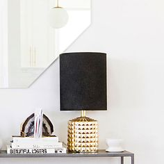 A black lampshade is like eyeliner for your room, defining and upping the drama.