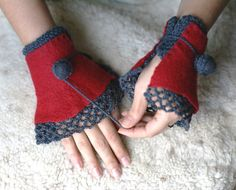 I'm a little addicted to fingerless gloves & wrist warmers, I think...? ;) Found & Pinned via: Joint project with Pronina. Handmade felted ruffled cuffs-mittens with crocheted laced edges in red and grey. $54.00, via Etsy.