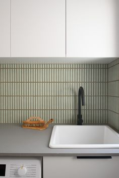 Laundry renovation with black tap and stone benchtop, featuring green kitkat tiles as a splashback Kitchen Splashback Tiles, Backsplash, Kitchen Colors, Kitchen Design, Stone Benchtop, Red Lily, Laundry Design, Laundry Room Inspiration, Feature Tiles