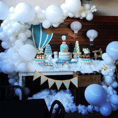 Fluffy white clouds   White organic balloon decorations for a hot air balloon theme cake table