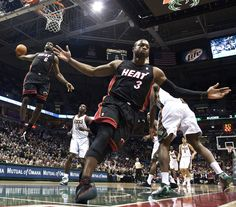 LeBron James (#6) and Dwyane Wade (#3)