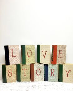 Our Love Story *Book Theme Wedding* Bridal Shower *Engagement Prop*Reception LOVE STORY , stenciled on Vintage Books for Wedding Reception or Bridal Shower THE ONES IN THE PHOTOS ARE SOLD ~ ONLY AN EXAMPLE Love Story stenciled on 9 Books ~ I can stencil another set on DIFFERENT BOOKS with colors you request ~ Feel free to contact me ~ I can send photos of choices ~ If you want just the word ~ LOVE ~ on 4 books ~ Those are listed here : https://www.etsy.com/listing/2190...