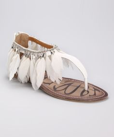 don't spend money on feather-trimmed sandals.  Make your own loose ankle bracelet with craft feathers so they drape over your existing shoes.  That way you don't feel bad when you have to throw the dirty/damaged feathers out.